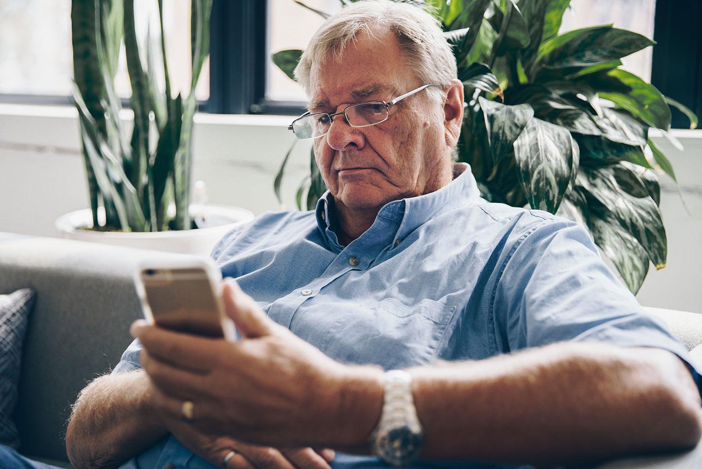 Older Man Using his Phone