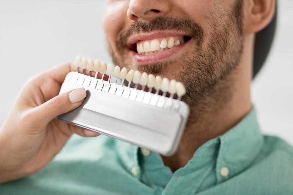 man-getting-tooth-veneers-smiling