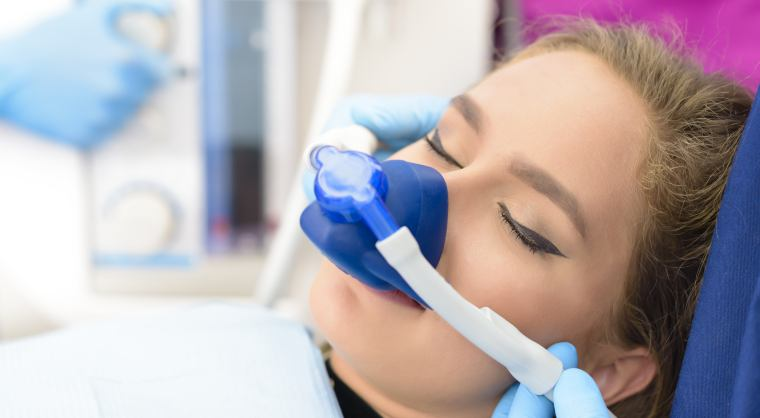 woman receiving inhalation sedation at dentist clinic