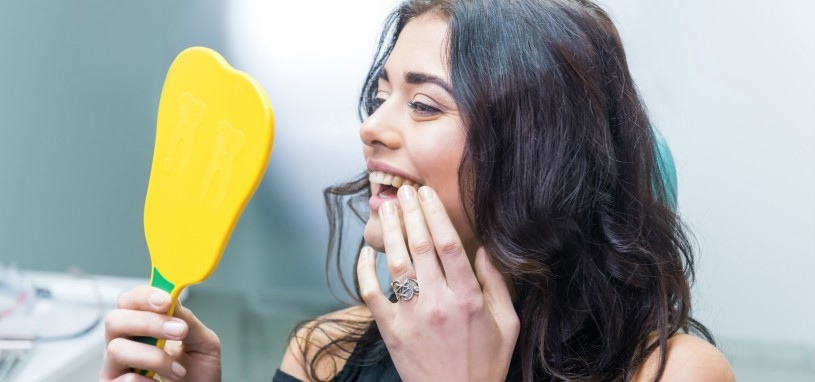 woman admiring her new all on 4 implants